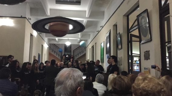 the choir concert was in an observatory, hence, the planets